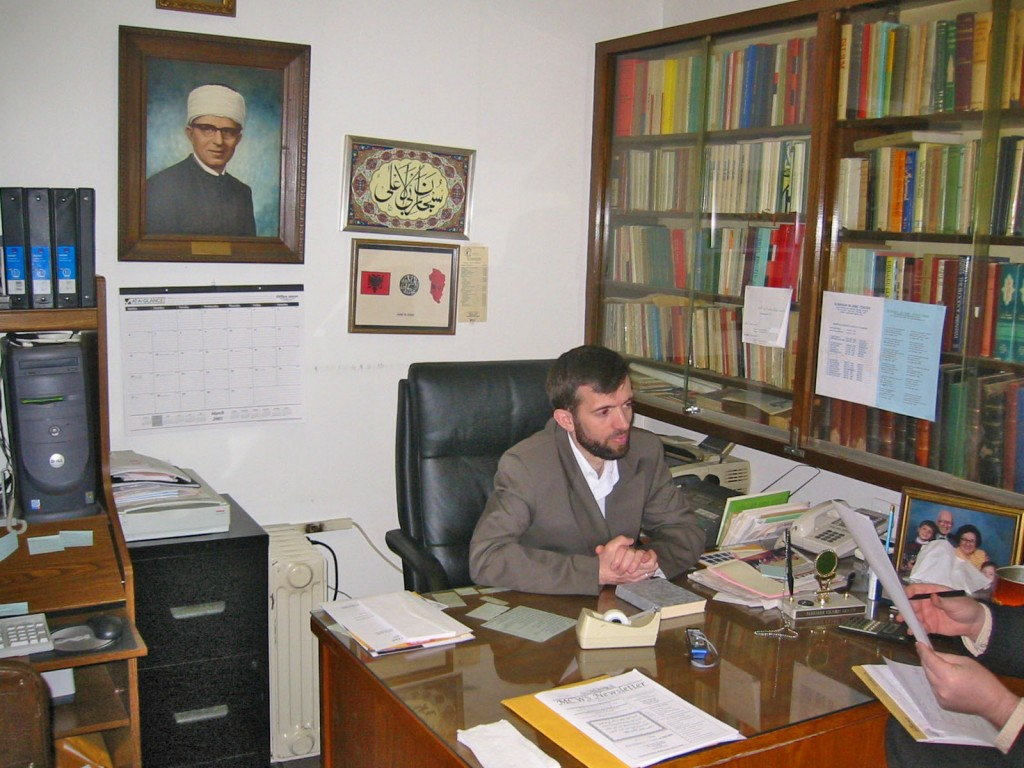 Imam Shuajb Gerguri discusses the history of the Albanian Islamic Center. Photo by Mucahit Bilici.