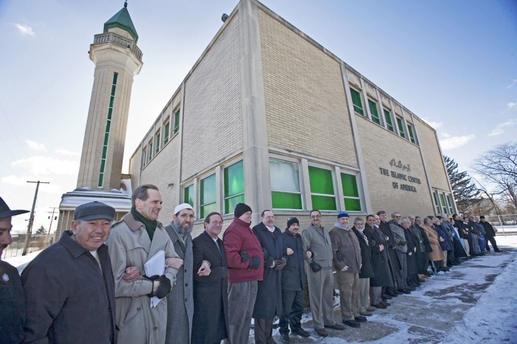 Christian, Jewish, and Muslim clergy join together to denounce mosque vandalism. Photo by Jim West.