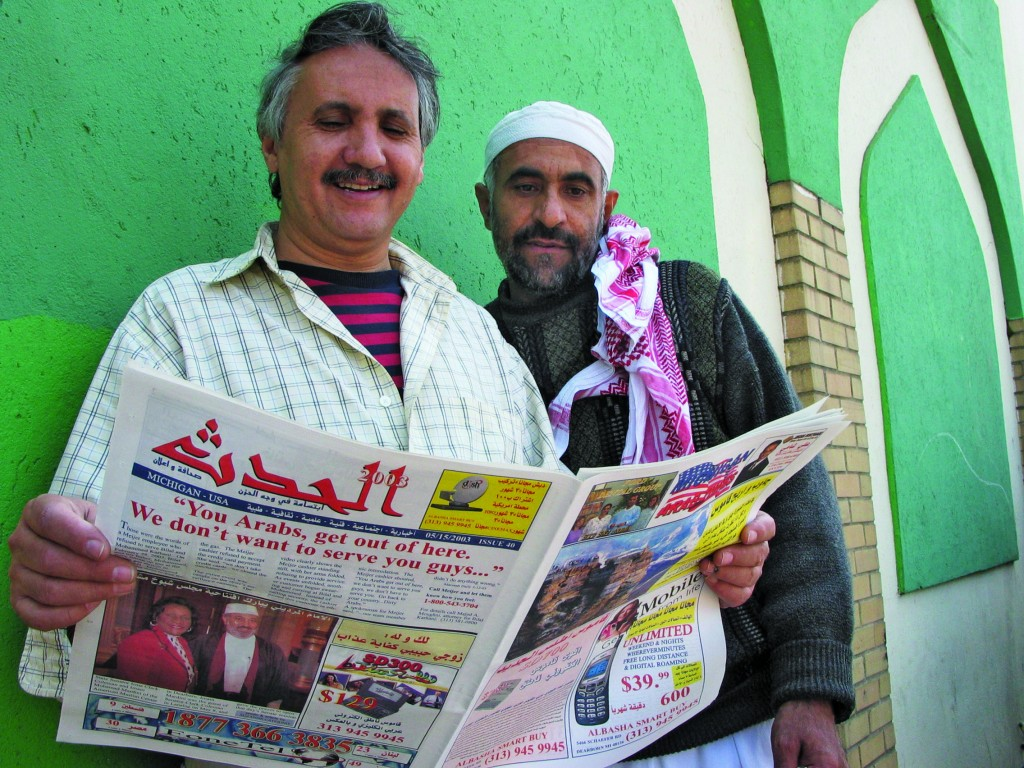 Sampling the local Arabic-English press. Photo by Jim West.